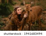 Redhead Girl With Deer In A...