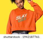 girl in an orange hoodie winter ...   Shutterstock . vector #1942187761