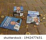 Small photo of HOLON, ISRAEL. March 24, 2021. Political propaganda flyers of three Israeli right wing politicians Benjamin Netanyah, Gideon Saar and Naftali Bennett left on the street after the Israel elections 2021