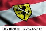 3D Illustration of a waving Austria city flag of Wolfsberg