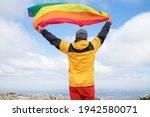 Hiker Waving A Rainbow Lgbt...