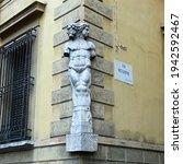 Small photo of Reggio Emilia, Emilia Romagna, Italy - 03.01.2021: The two-faced statue of Janus on the corner of Palazzo Magnani