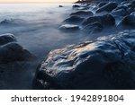 Sea Water Washing The Rocks On...