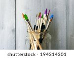 photo of paint brushes in a jar | Shutterstock . vector #194314301