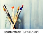 photo of paint brushes in a jar | Shutterstock . vector #194314304