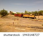 Small photo of LAMY, NM, USA - MAY 25 2013: Santa Fe locomotive #93 and boxcar are sidetracked at Lamy Amtrak station, in front of the abandoned Old Church on Old Lamy Trail.
