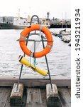 An Orange Lifebuoy On A Stand...