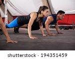 beautiful young brunette doing... | Shutterstock . vector #194351459