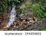 small natural waterfall falling ...