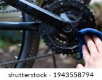 Man Cleaning Chain And Gears Of ...