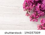 Stock photo purple lilac on a wooden background studio photography 194357009