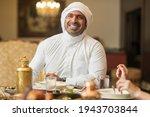 Arabian Man Eating Iftar In...