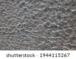 Tiny Sea Water Waves On The...