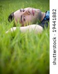 portrait of a relaxing in the green grass - stock photo
