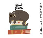 cute funny cat luing on book... | Shutterstock .eps vector #1944475807