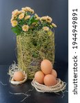 Easter Eggs And Flowers In A...