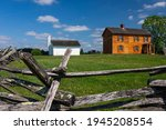 The wooden Henry House on Henry Hill at Manassas National Battlefield Park on a sunny Summer Day