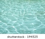 This is a background shot of some crystal clear aqua colored water. - stock photo