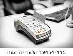 Small photo of Bank terminal and payment card on the office table