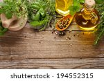 herbs spice and oil on wooden... | Shutterstock . vector #194552315