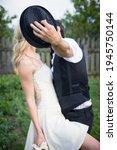 Wedding Couple Kissing And...