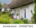 White Cottages With Thatched...