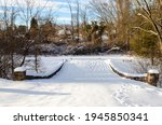 Snow Covered Foot Bridge After...