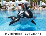 Inflatable Whale Floating In A...