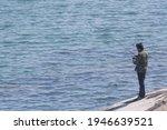 Angler Standing On Rocks At Hua ...