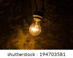 Old Light Bulb In Cave.