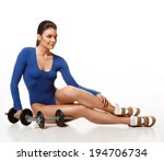 woman bodybuilder posing after... | Shutterstock . vector #194706734