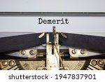 Small photo of Demerit symbol. The word 'demerit' typed on retro typewriter. Business, demerit concept. Beautiful white background.
