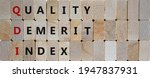 Small photo of QDI, quality demerit index symbol. Wooden blocks with words 'QDI, quality demerit index'. Beautiful wooden background, copy space. Business and QDI, quality demerit index concept.