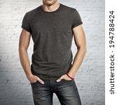 man wearing dark grey t shirt | Shutterstock . vector #194788424