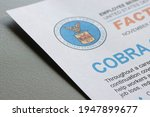 Small photo of Portland, OR, USA - Apr 1, 2021: Closeup of the COBRA (Consolidated Omnibus Budget Reconciliation Act) Continuation Coverage fact sheet by the United States Department of Labor.