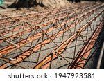 Small photo of Close up on lattice girder and truss girders steel roof truss for concrete precast with ceramic elements ready for installation on the construction site or warehouse in sunny day