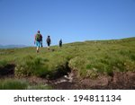 People Hiking On Path To The...