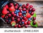 berries mix on rustic background | Shutterstock . vector #194811404