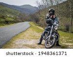 Young Biker Putting His Black...
