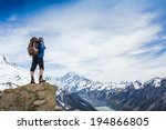 hiker at the top of a rock with ... | Shutterstock . vector #194866805