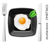 Served breakfast. Fried egg on black plate served with fork and knife - stock vector