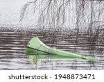 Green Flooded Canoe Lying In...