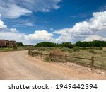 Dirt Road With Wooden Fence In...