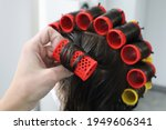 Young Woman With Hair Curlers...