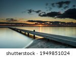 Wooden Jetty In A Calm Lake At...