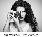 Portrait of beautiful woman with the camera. Girl photographer. Fashion photo - stock photo