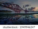 Sunset Sky And Reflection At...