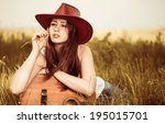 pretty young woman in hat at... | Shutterstock . vector #195015701