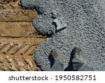 Small photo of spilled concrete on the construction site solidified and lock paving was thrown inside. The landscape is generally concreted in a ruthless building industry. the concrete is already hard