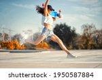 Asian Women Hold Surf Skate Or...